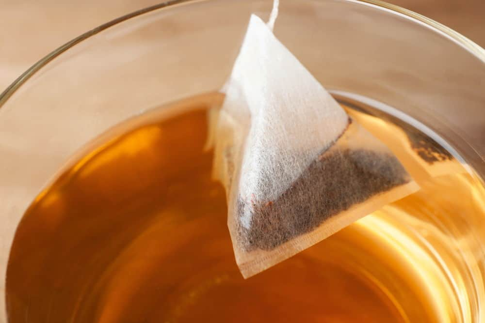teabag in cup with hot fresh drink
