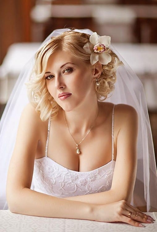 Curly Wedding Hairstyle with an Orchid